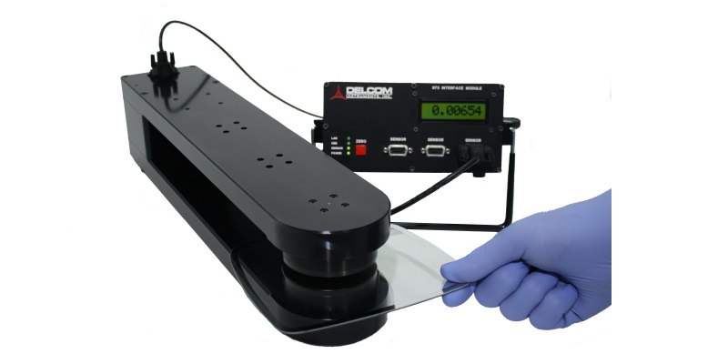 Non-contact eddy current instrument for measuring the sheet conductance or Ohms/sq of conductively coated glass, conductive glass, solar, PV or other thick materials.